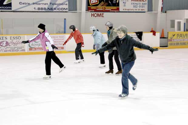 Arlene Deck (shown at left) leads the group in a series of simple moves that promote strength and balance.