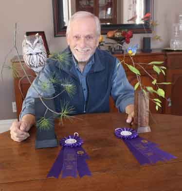 Bruce Lepper with the carvings that earned him two 1st place purchase awards at the Canadian National Wildfowl Carving Championship held last week.