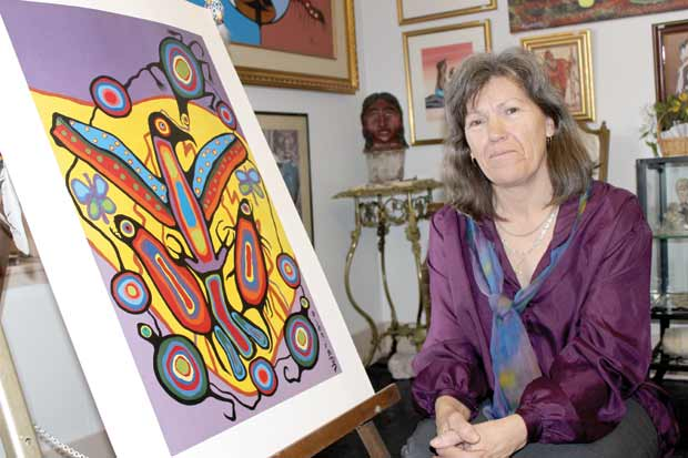 Sherry Crawford, owner of Crawford Fine Art, is particularly proud of the gallery's Norval Morrisseau paintings.
