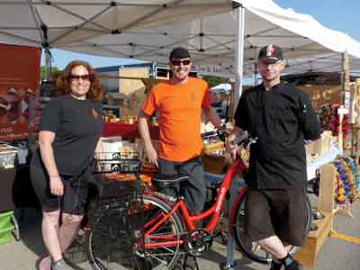 Deanna, friend Eric of Frogcycles, and Colin at the Peterborough Farmers' Market. Photo by Karen Graham
