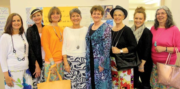 Oasis Boutique owner Nancy Fallis (centre in white) with her volunteer models (l-r) Debbie, Cathy, Jill, Alice, Ruth and Bonna, with daughter Jackie, second from right, assisting as dresser for the evening. Photo: Celia Hunter