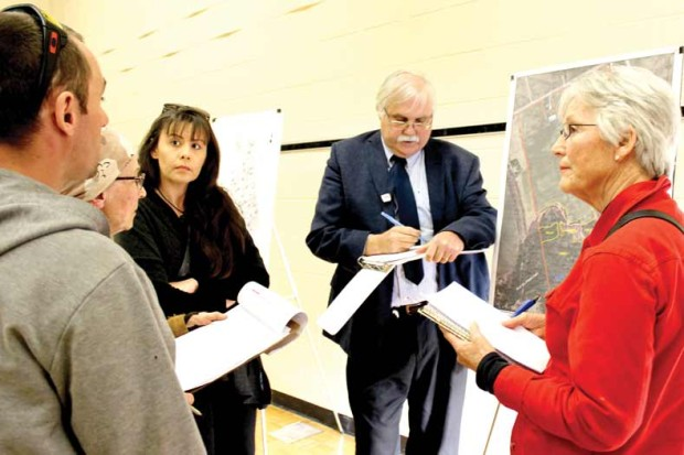 Cavan Monaghan ratepayers Mitch Conrad, Grace Glass, Anca Pascalau and Marion Thompson ask Nyle McIlveen of Geo-Logic Inc. questions about the effects of the proposed development on water at the Open House hosted by Towerhill Development and Innovative Planning Solutions. Photo: Celia Hunter