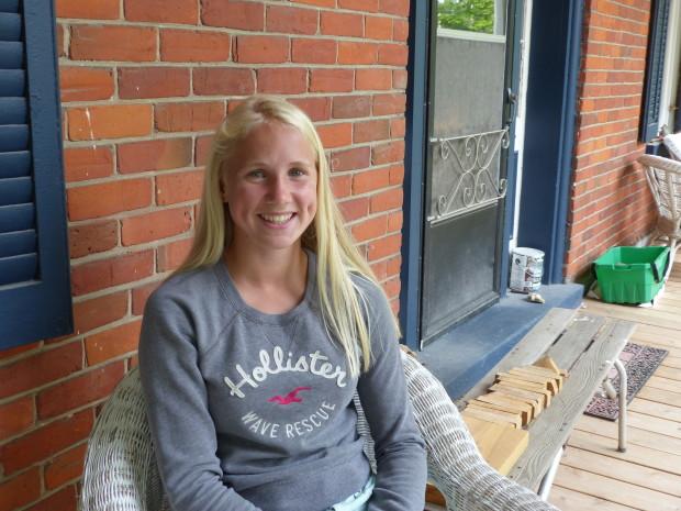Gillian Webster takes a break on her front porch. Photo: Karen Graham