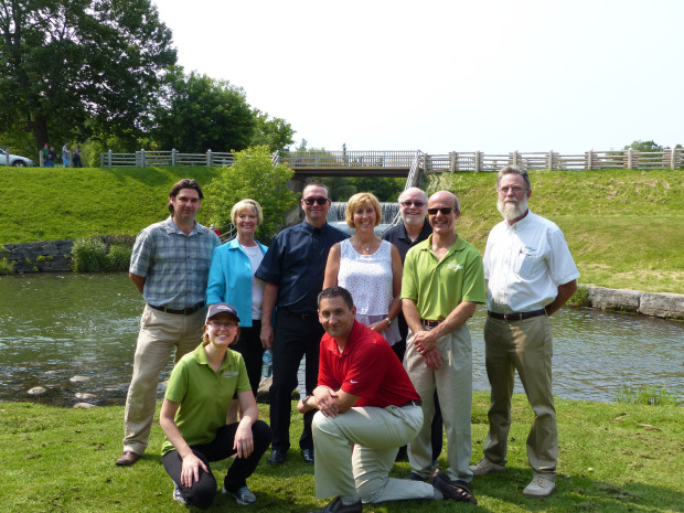 Dignitaries celebrate the receipt of funding to rehabilitate the Millbrook Dam last Friday.  Pictured from left to right, back row Millbrook Councillor Ryan Huntley, ORCA Vice Chair Sherry Senis, MP Barry Devolin, MPP Laurie Scott, Councillor Tim Belch and Deputy Mayor John Fallis.  Front row Councillor Jordan Landry and future PC candidate Jamie Schmale.