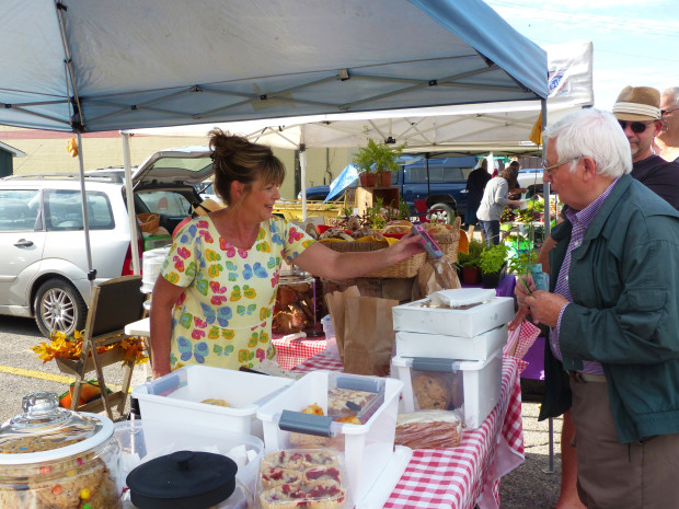 Claire serves one of her many customers. Photo: Karen Graham.