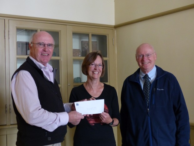 Paul and John Downs of Nexicom present Celia Hunter with a $5000 cheque towards the Save the Mill project.  Photo: Karen Graham.