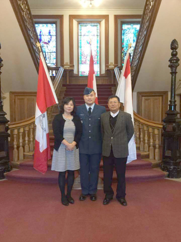 Andrew Kim, flanked by his parents, at his Commissioning Ceremony in Kingston. Photo: Supplied.