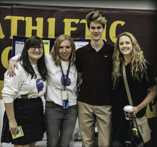 Millbrook teacher Julie Vallieres flanked by students in her Mental Health Initiative Group.  Photo: Supplied.