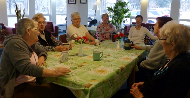 Millbrook Manor residents enjoy Monday morning camaraderie in the lounge
