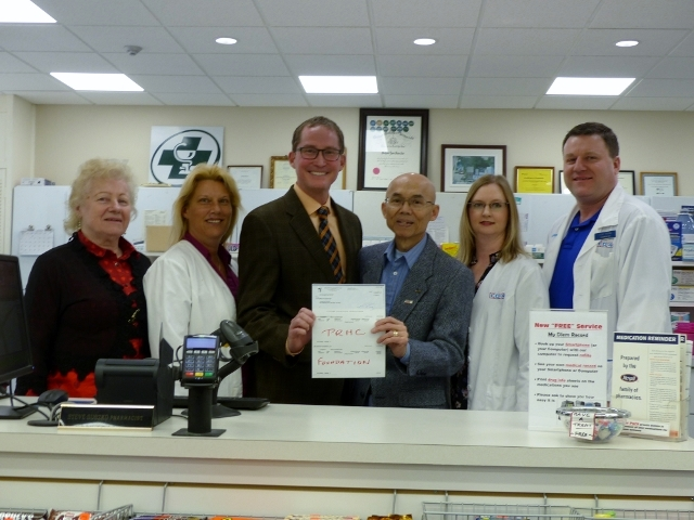 """Millbrook Pharmacy Donation: Steven MacDonald Manager, Philanthropy for PRHC Foundation was on hand Saturday to accept a donation from Millbrook Pharmacy.  Pictured from left to right are Bonnie Suszko-Tong, Lana Tower, Steven MacDonald,  David Tong, Joe Sweeney,  and Steve Suszko.  """"We are pleased to accept this donation in support of patient care, equipment and technology on behalf of the Peterborough Regional Hospital Foundation.""""  For more information about how donor generosity impacts patient care at our regional hospital, contact Steven at smacdona@prhc.on.ca or visit prhcfoudation.ca."""