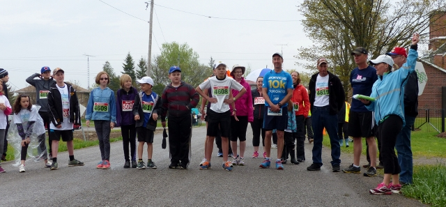 Runners for the Country Mile Walk line up at the starting line to head down Zion Line.