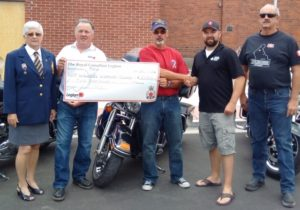 The Millbrook Legion presents a $2000 donation to Wounded Warriors raised through their Motorcycle event last month. Pictured from left to right: Diann Corfe, Rob McKend, Roger Saunders, David Macdonald of Wounded Warriors, and Gord Orr.