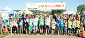 Participants line up at the starting line at the McCamus farm to begin the event.