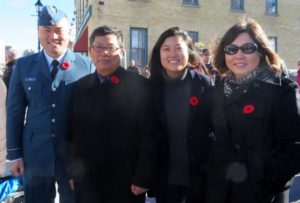Photo Karen Graham The Kim family joined together at the Millbrook Remembrance Day Service to pay their respects.