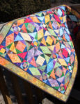 Handcrafted Quilt and Stained Glass Image Pay Homage to Blocks and Blooms Event
