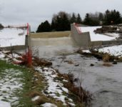 Water began flowing over the new dam